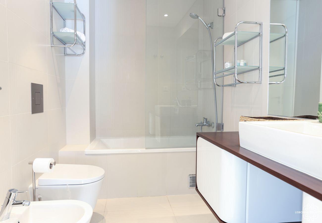 High-end bathroom with wooden vanity basin