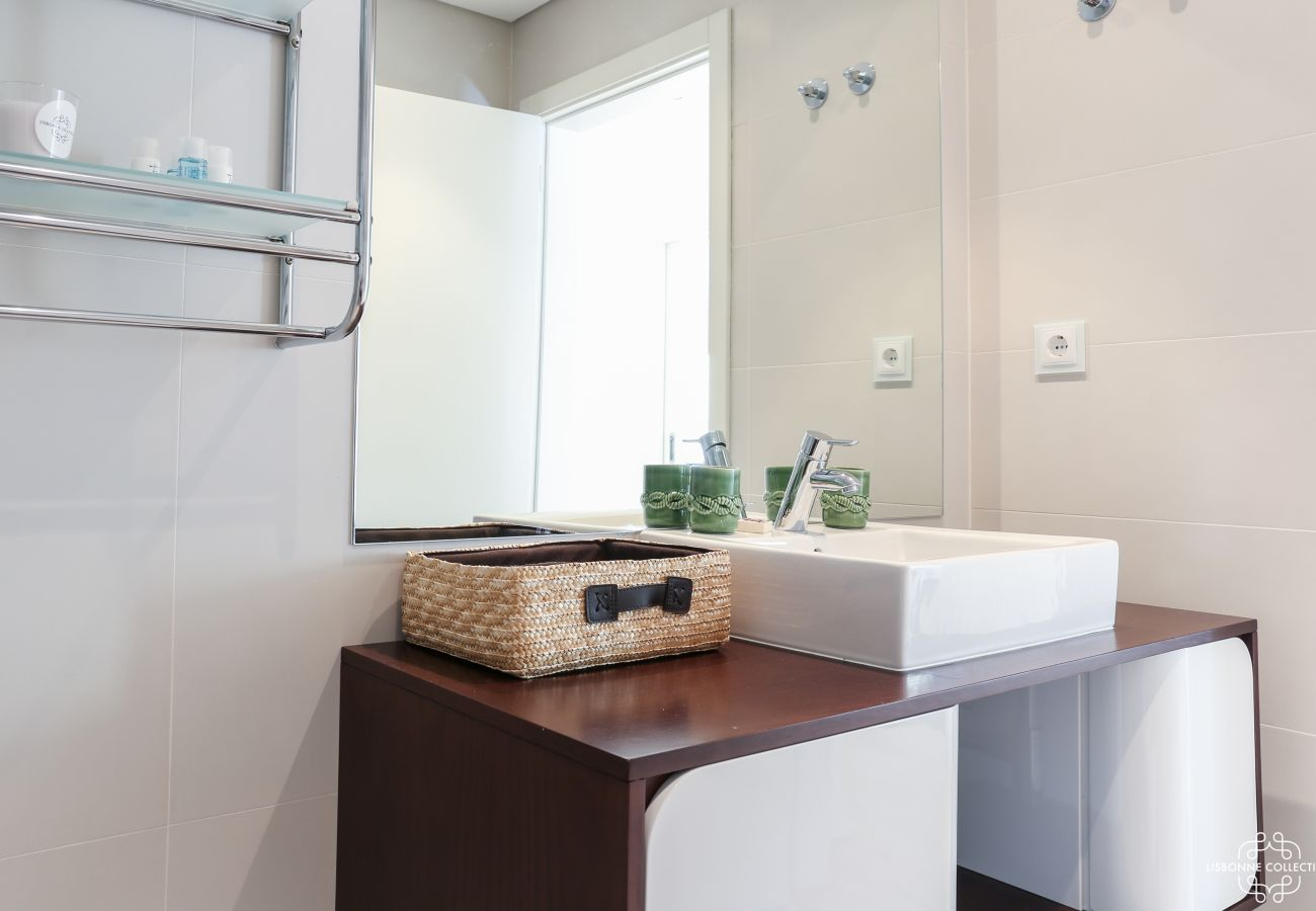 Design bathroom with ceramic basin and wooden furniture
