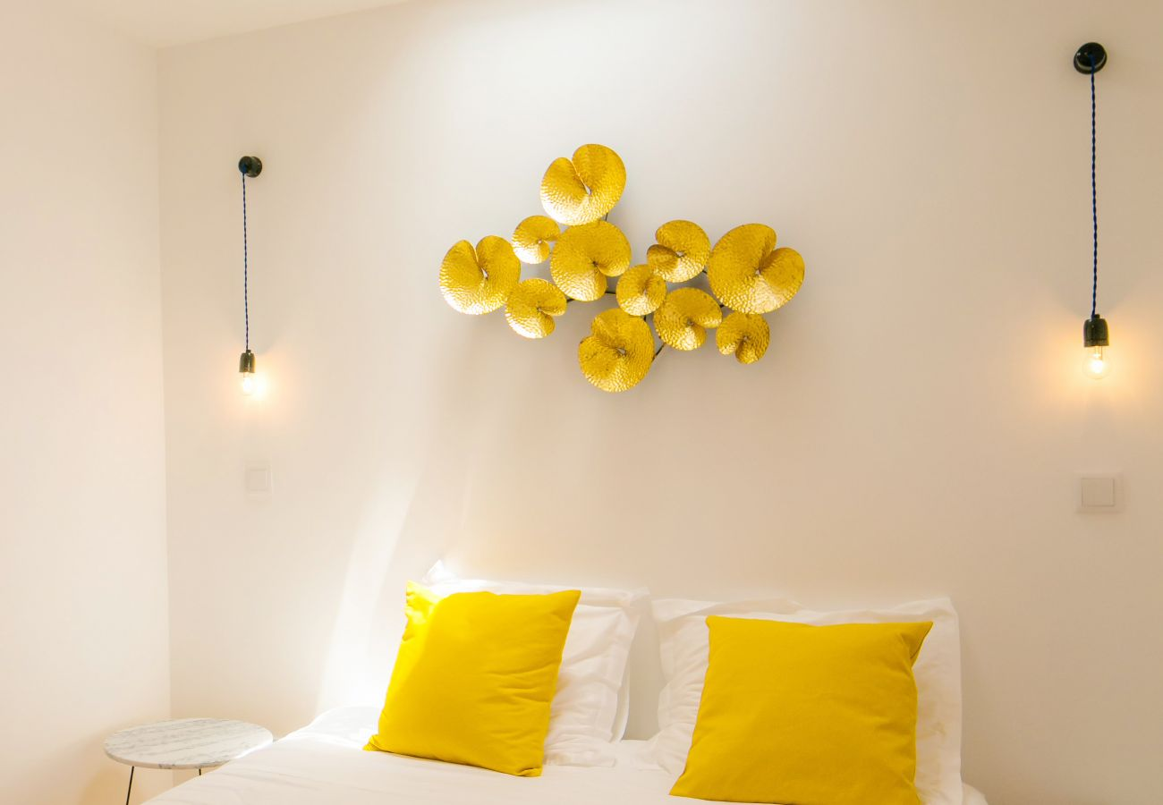 double room for adults with wall decoration in a rental accommodation