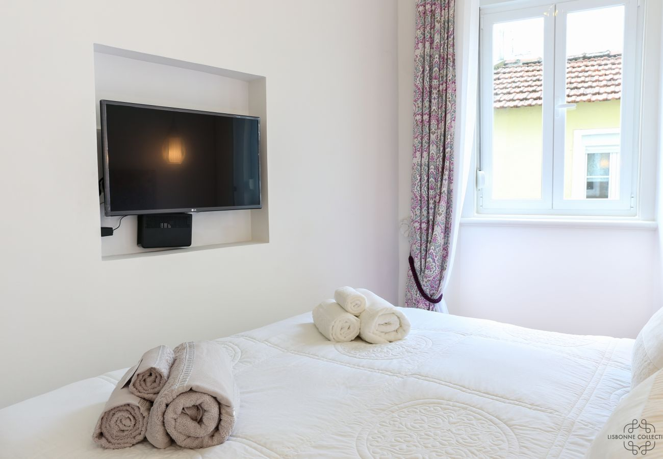 double room for adults with TV inlaid in the wall
