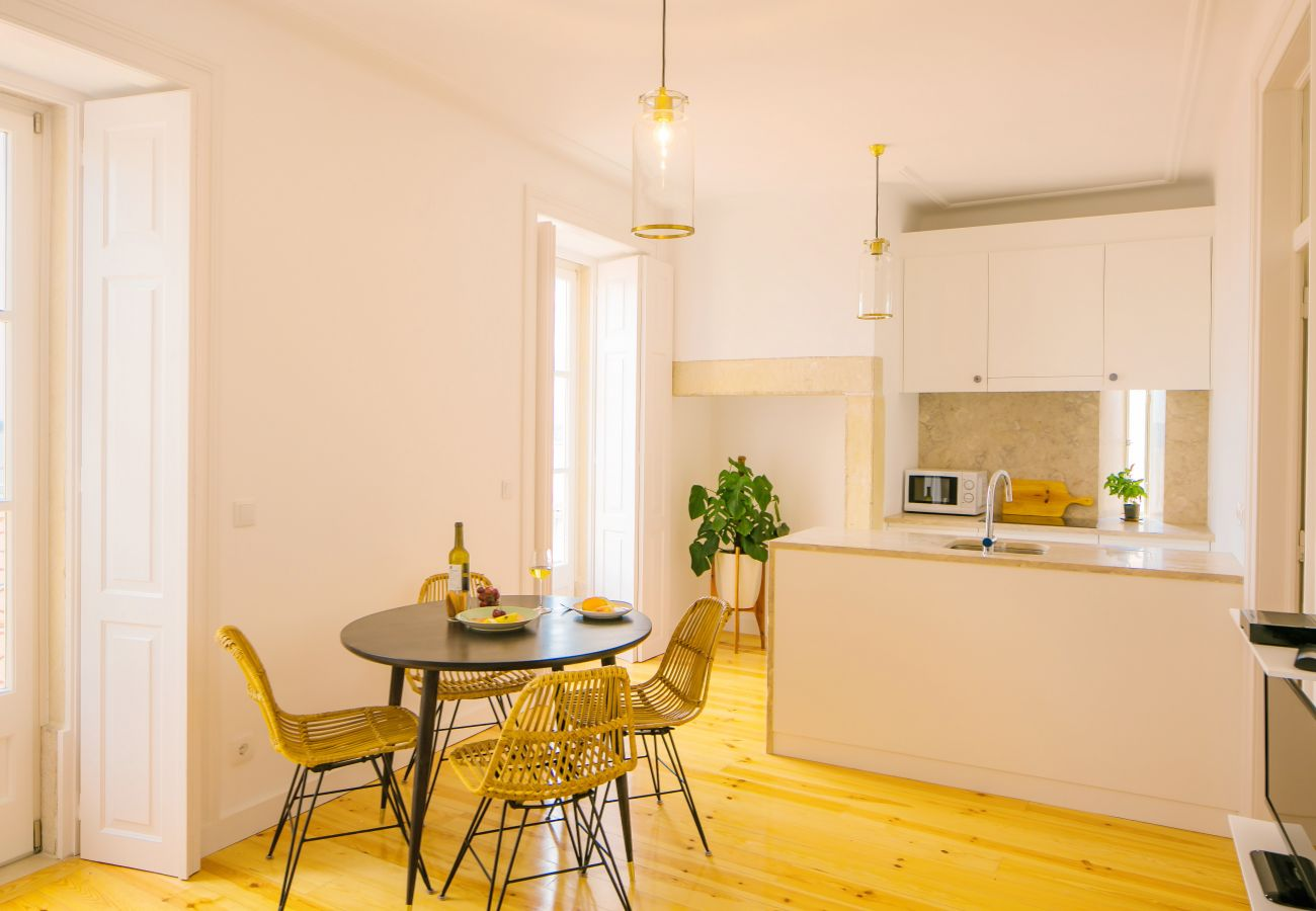 kitchen dining room with outdoor access with views of the city center