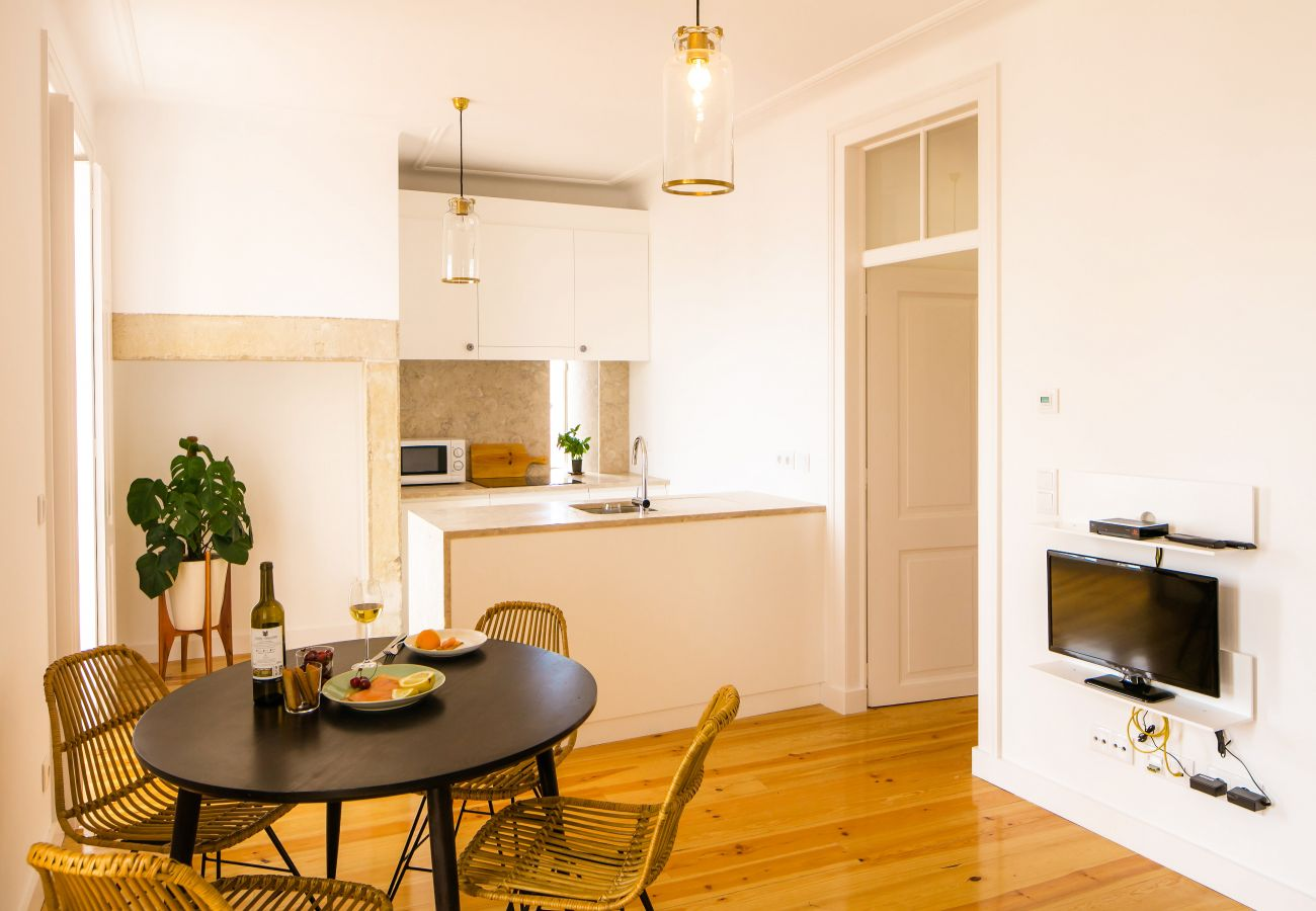 kitchen and dining room with access to corridor and bedrooms