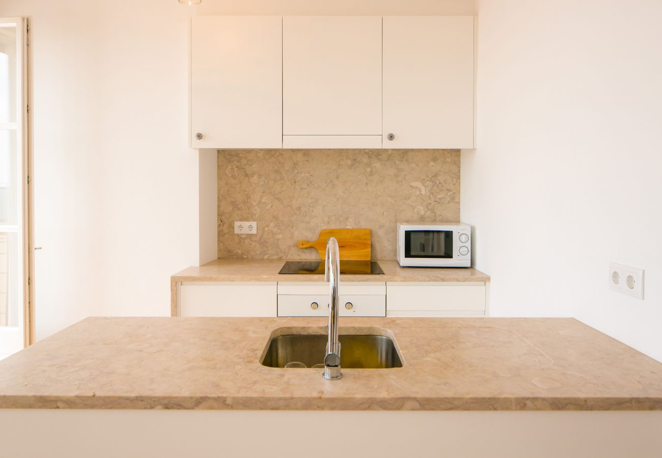 marble kitchen in a luxury apartment with terrace