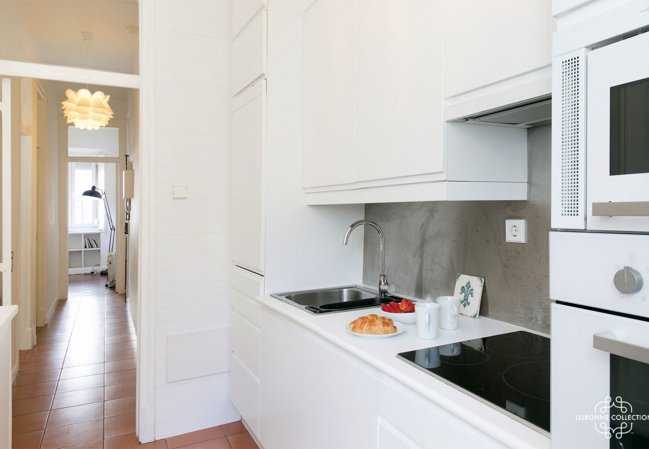 luxurious kitchen overlooking the entrance hallway with oven, microwave, hob