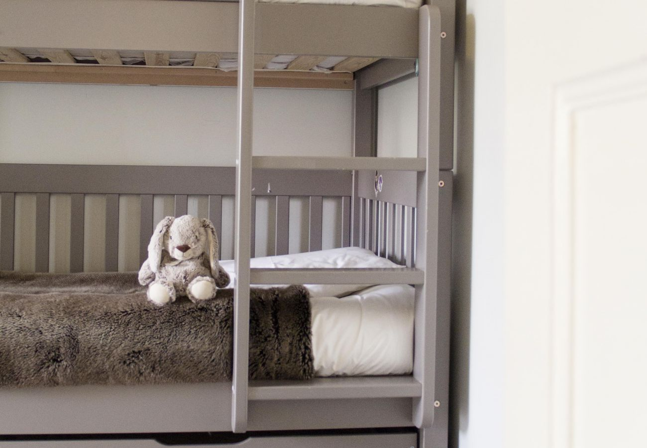Child's play area with bunk beds in soft tones