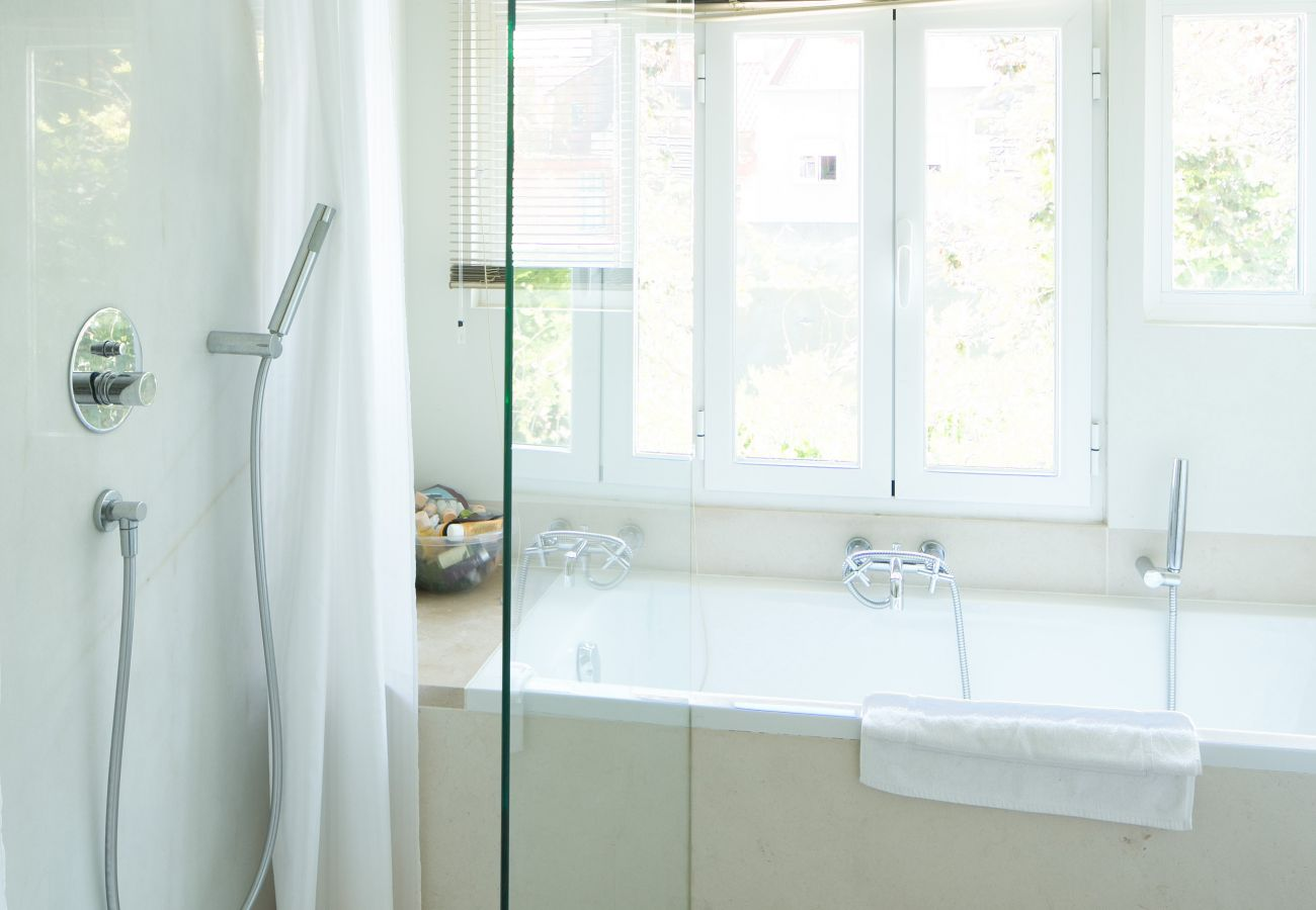 bright and uncluttered bathroom with bathtub and shower