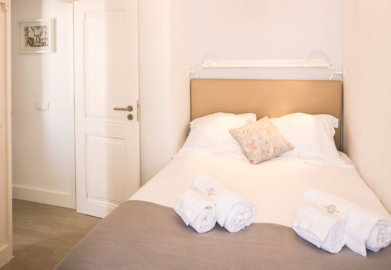 Double bed with folded towels on the bed in the historic center of Lisbon