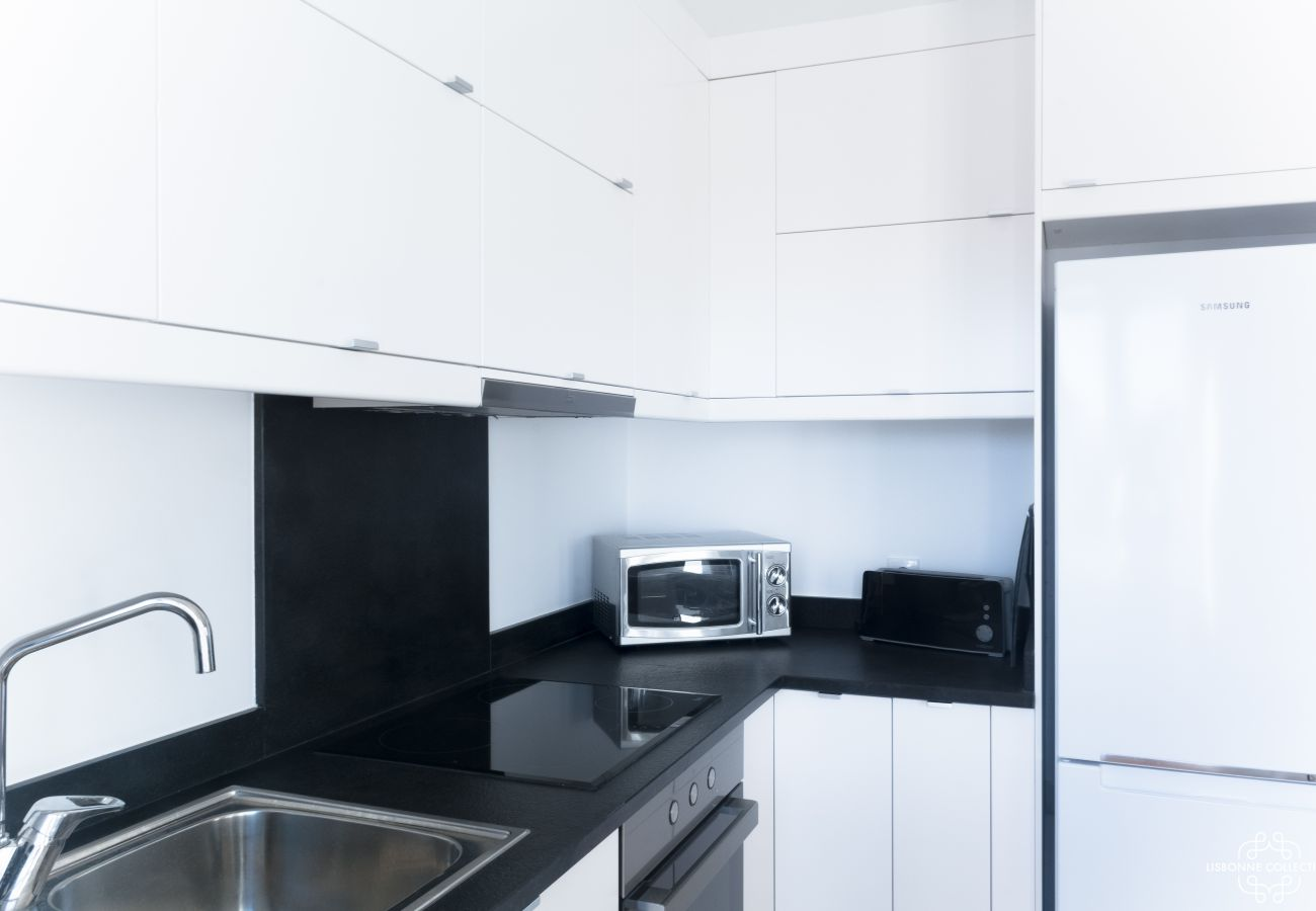 Large modern black and white kitchen with microwave