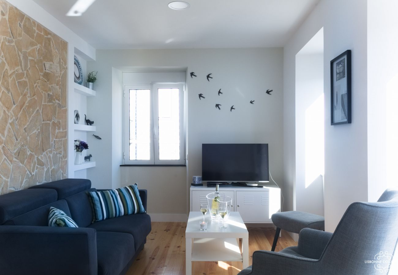 Large living room converted into a rental for a stay in Lisbon