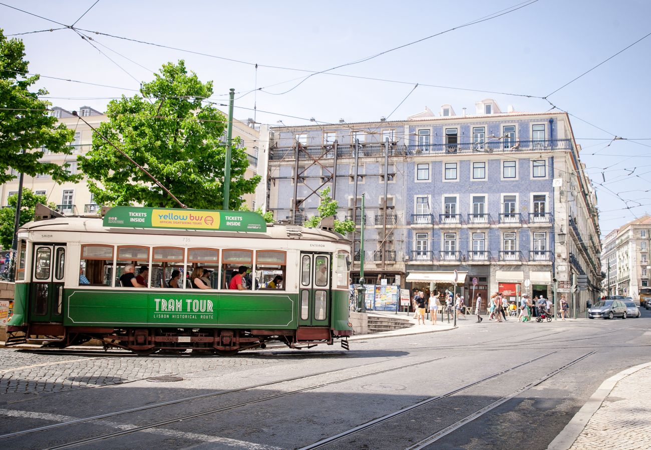 Large square in Lisbon with a typical tram from the Portuguese capital