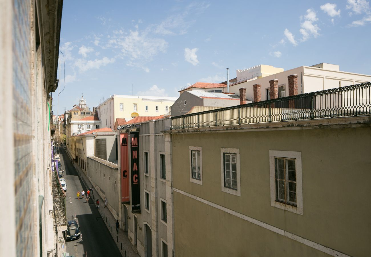 View of the living room window on the Chiado district for your future holidays