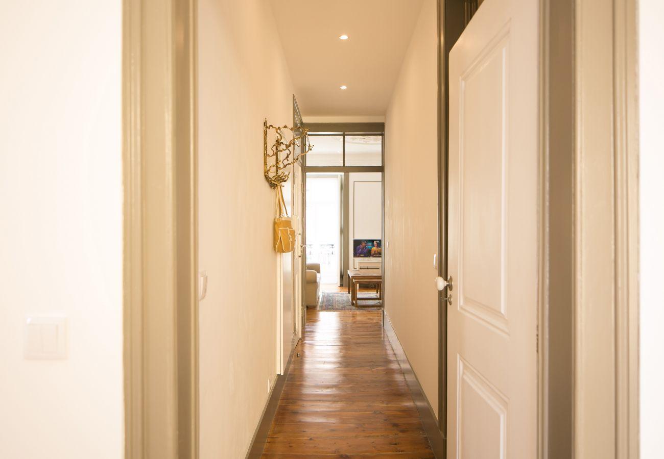 Long corridor overlooking the kitchen, living room, bedroom and bathroom