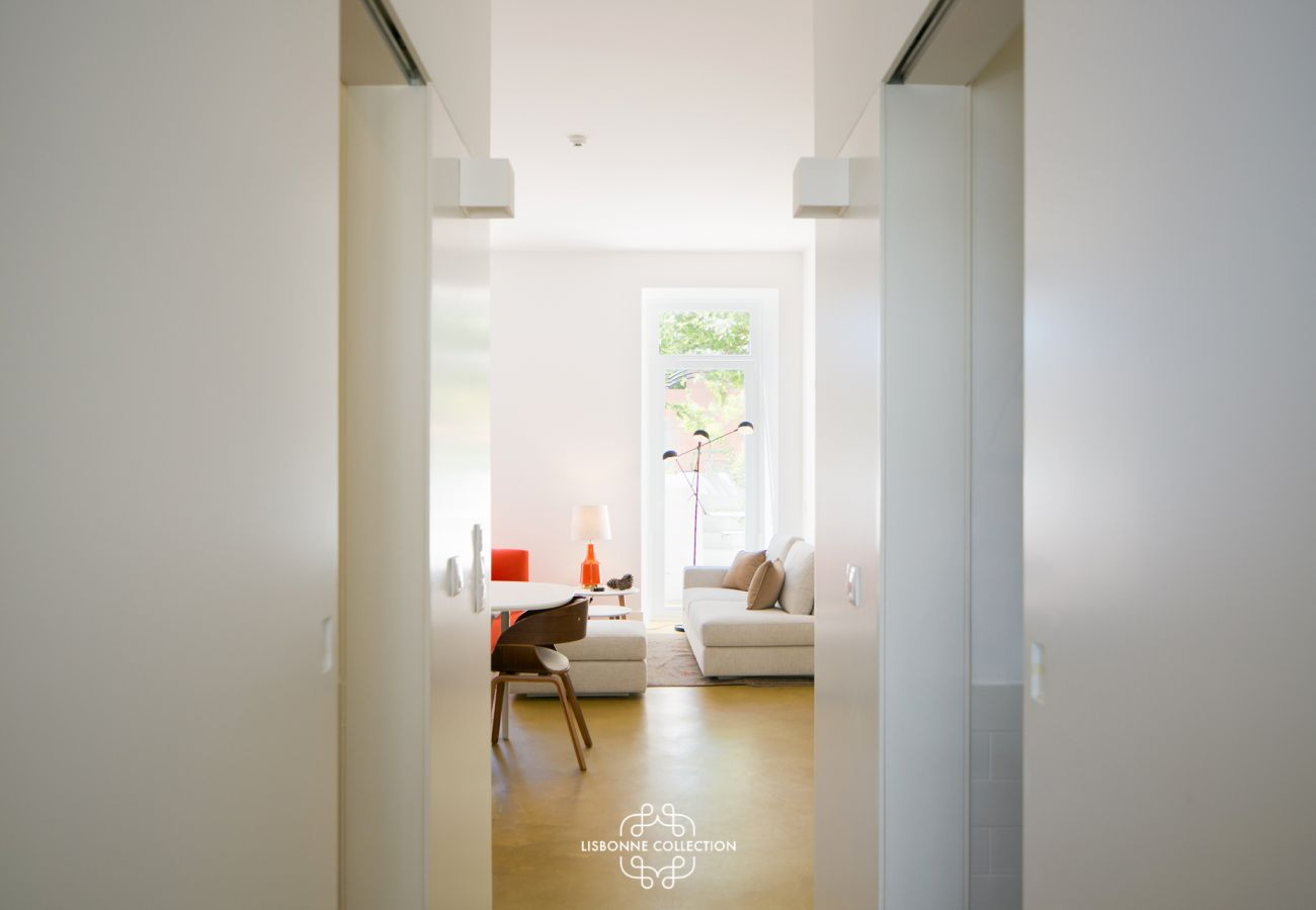 Corridor leading to a living room with terrace in the background