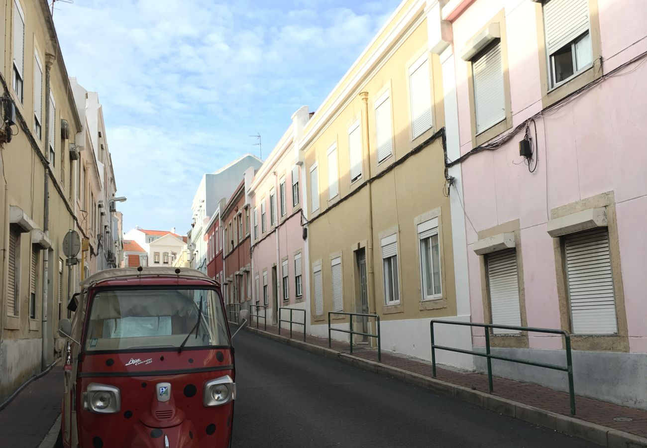 Typical Lisbon street with tuk tuk to visit the city center