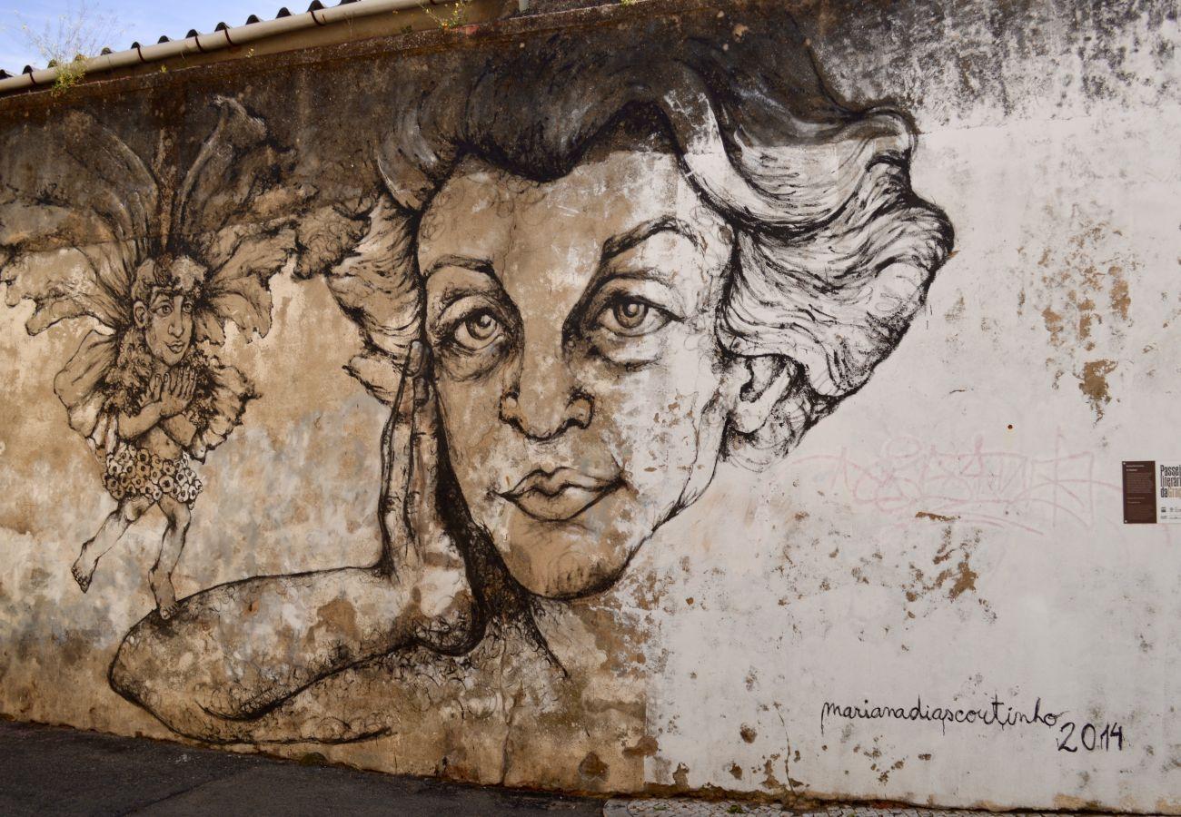 Street art in the historic district of Graça in Lisbon