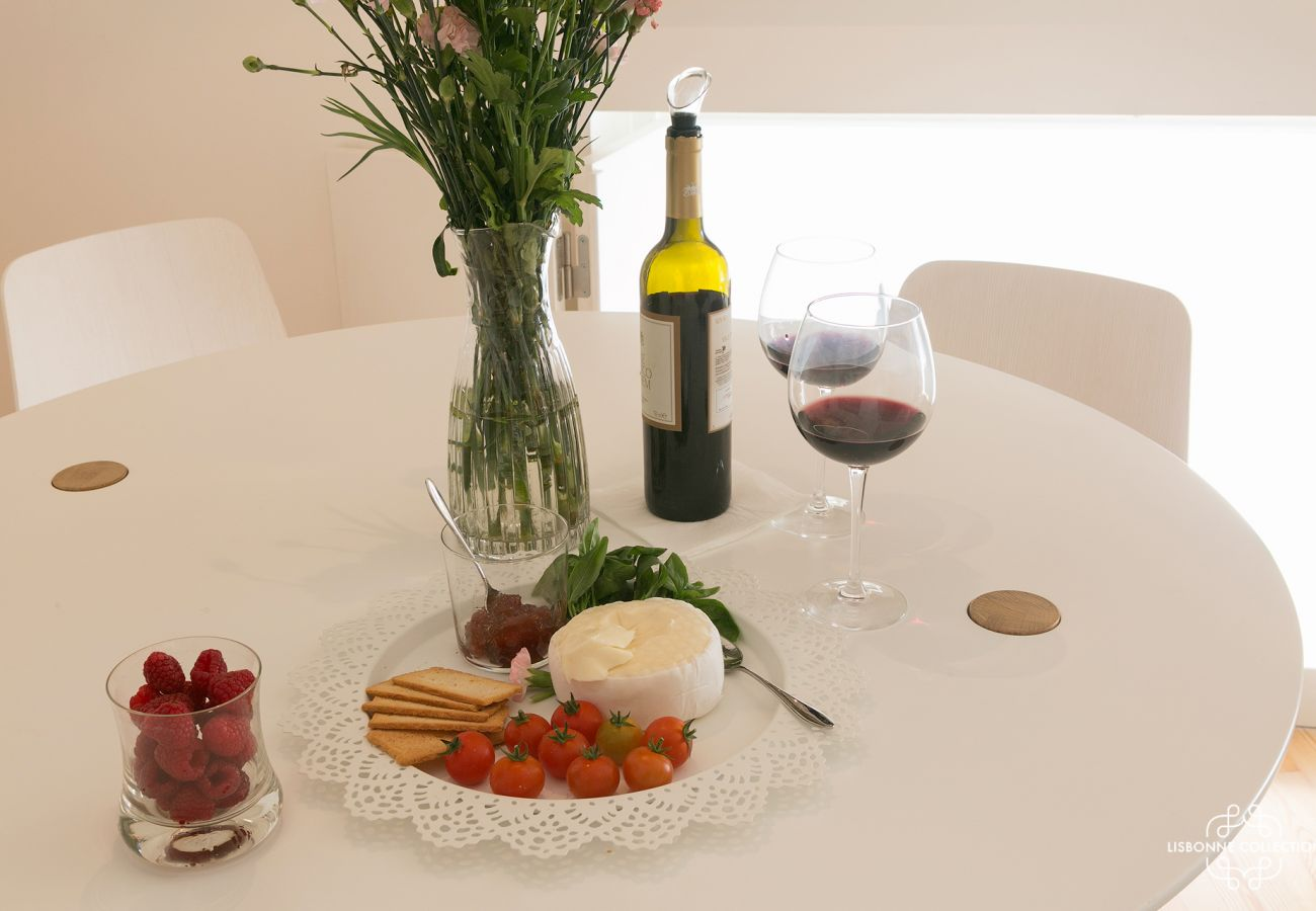 Ready-to-use table with bottle of wine and dessert