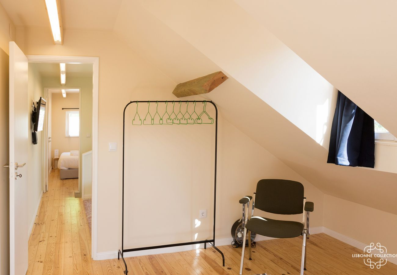 Trendy wardrobe with chair in a room for 2 guests