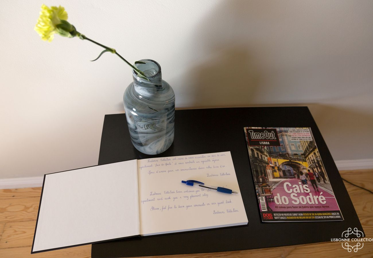 Guest book with decoration, magazine and yellow flower