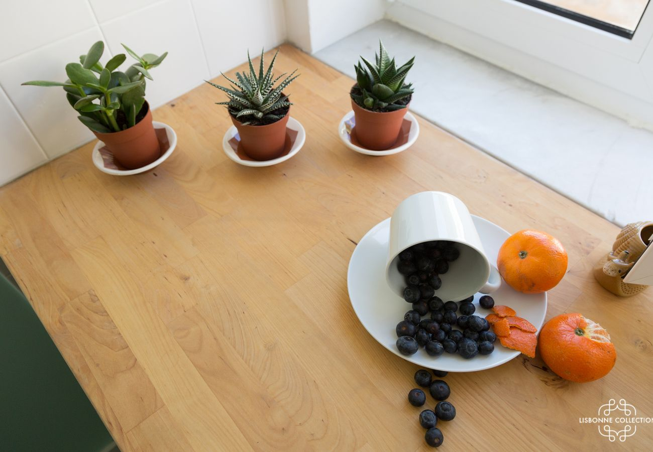 Small cactus and fruit paused on the kitchen worktop