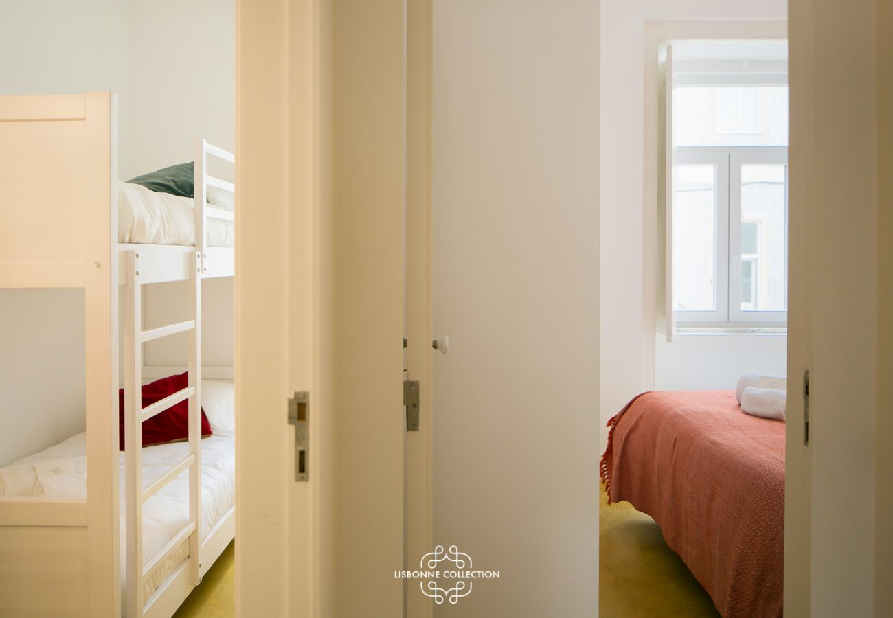 A double room for adults and a children's room with loft bed