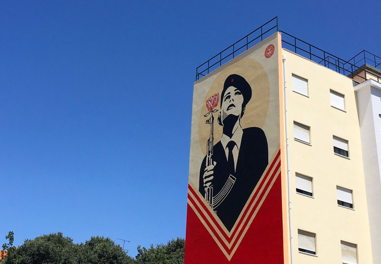 Red-dominant street art in the Graça district of Lisbon