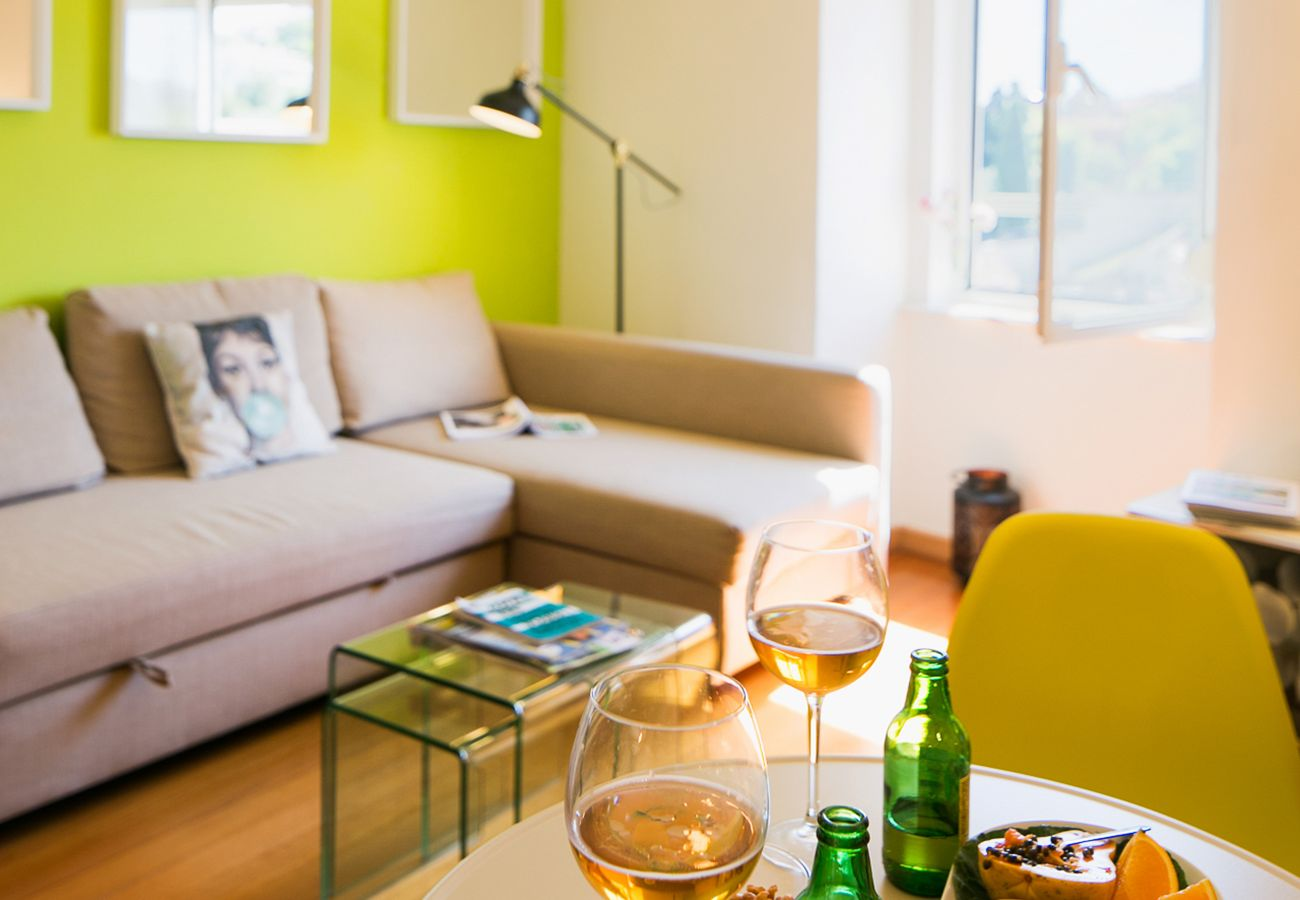 Living room with TV and sofa bed for rent for a stay in Lisbon