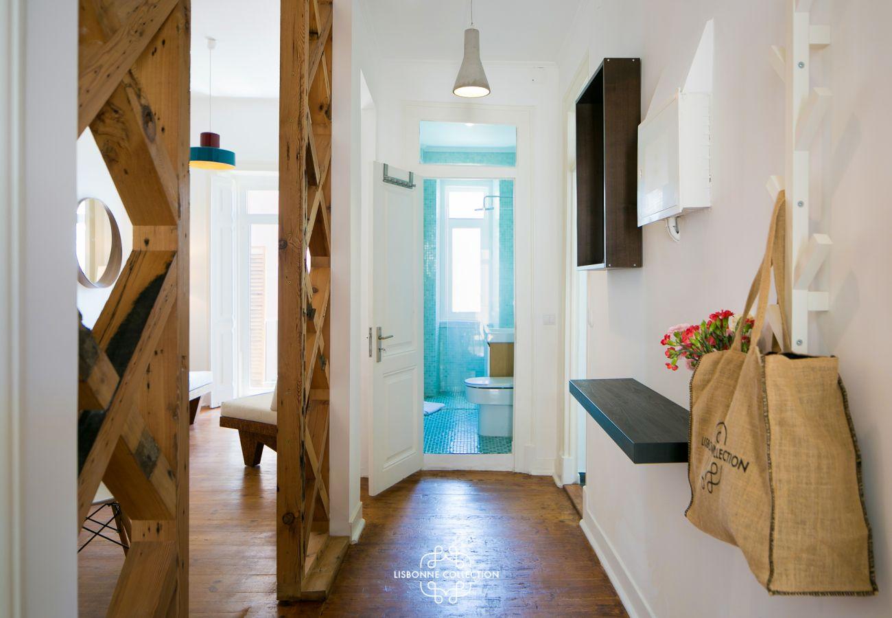 Main corridor overlooking the kitchen, living room and bedrooms