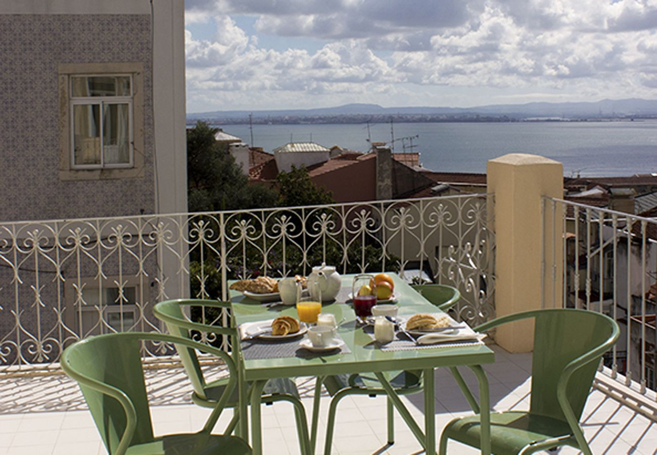 Furnished terrace overlooking the Tagus River and the whole city