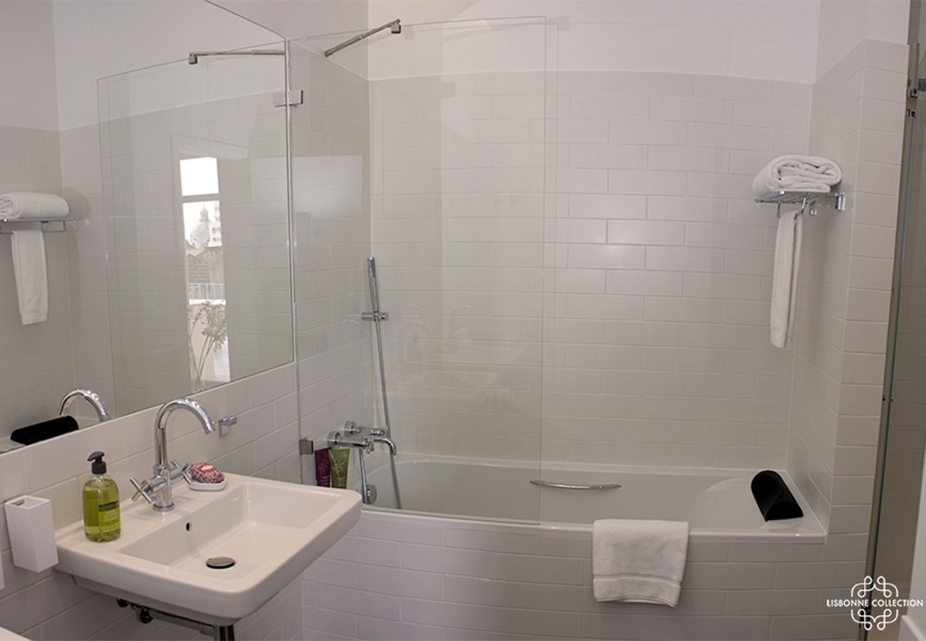 White bathroom with standing bathtub