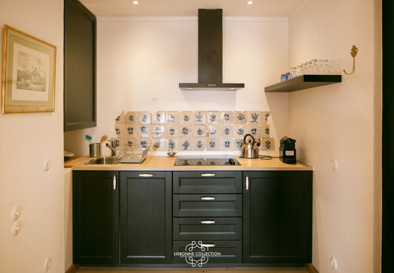 Kitchen with tiled floor and wooden furniture in an apartment for rent