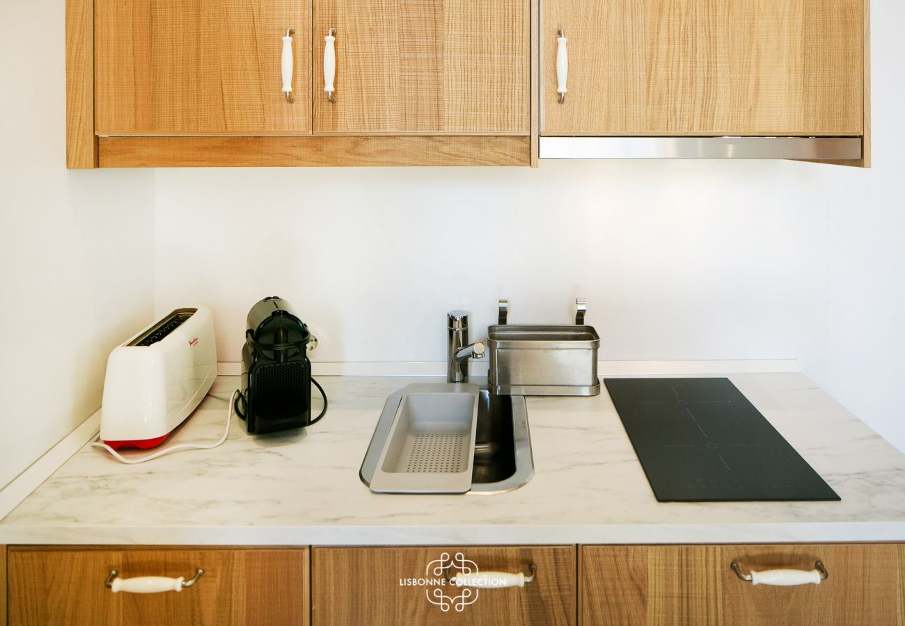 Worktop of the kitchen with electric hob, toaster and coffee maker