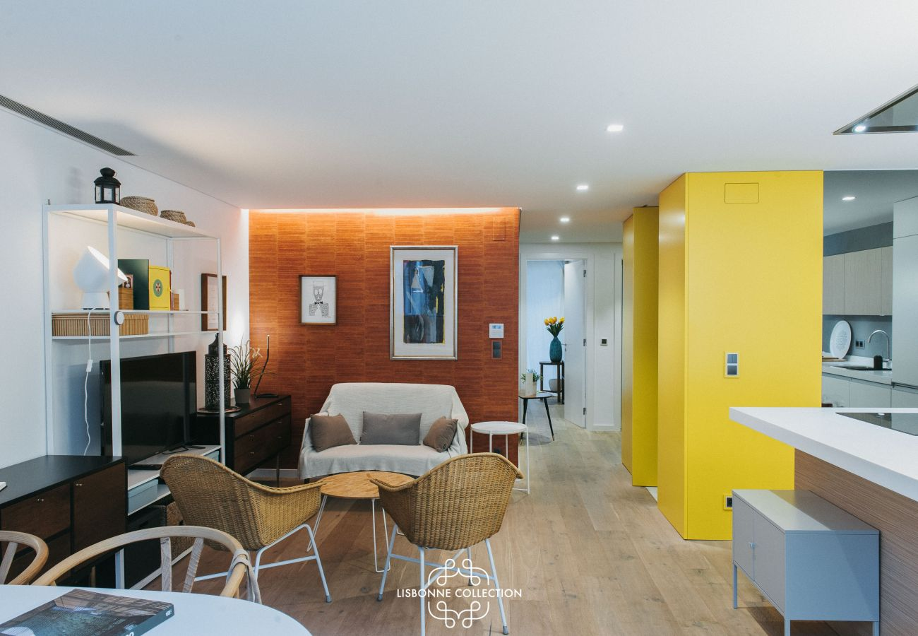 Hall-to-eat lounge and colorful kitchen fully equipped with microwave oven