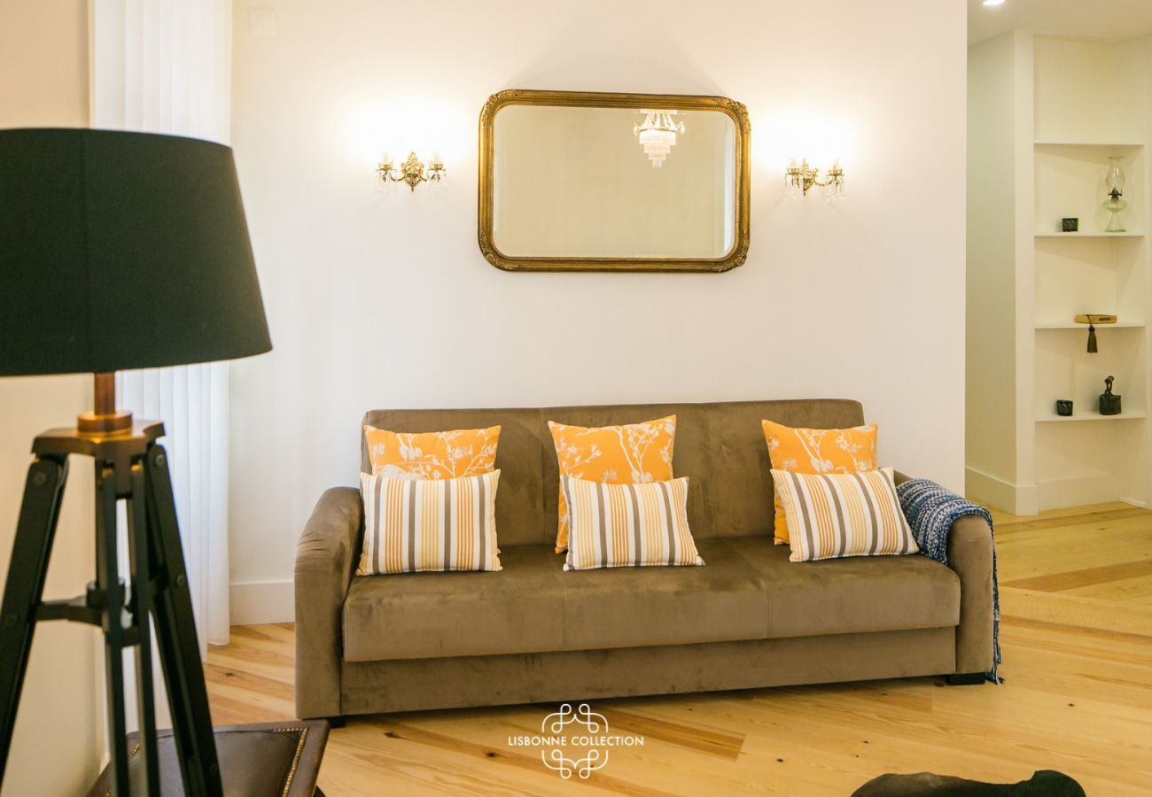 living room with sofa, design lamp and old parquet in Lisbon