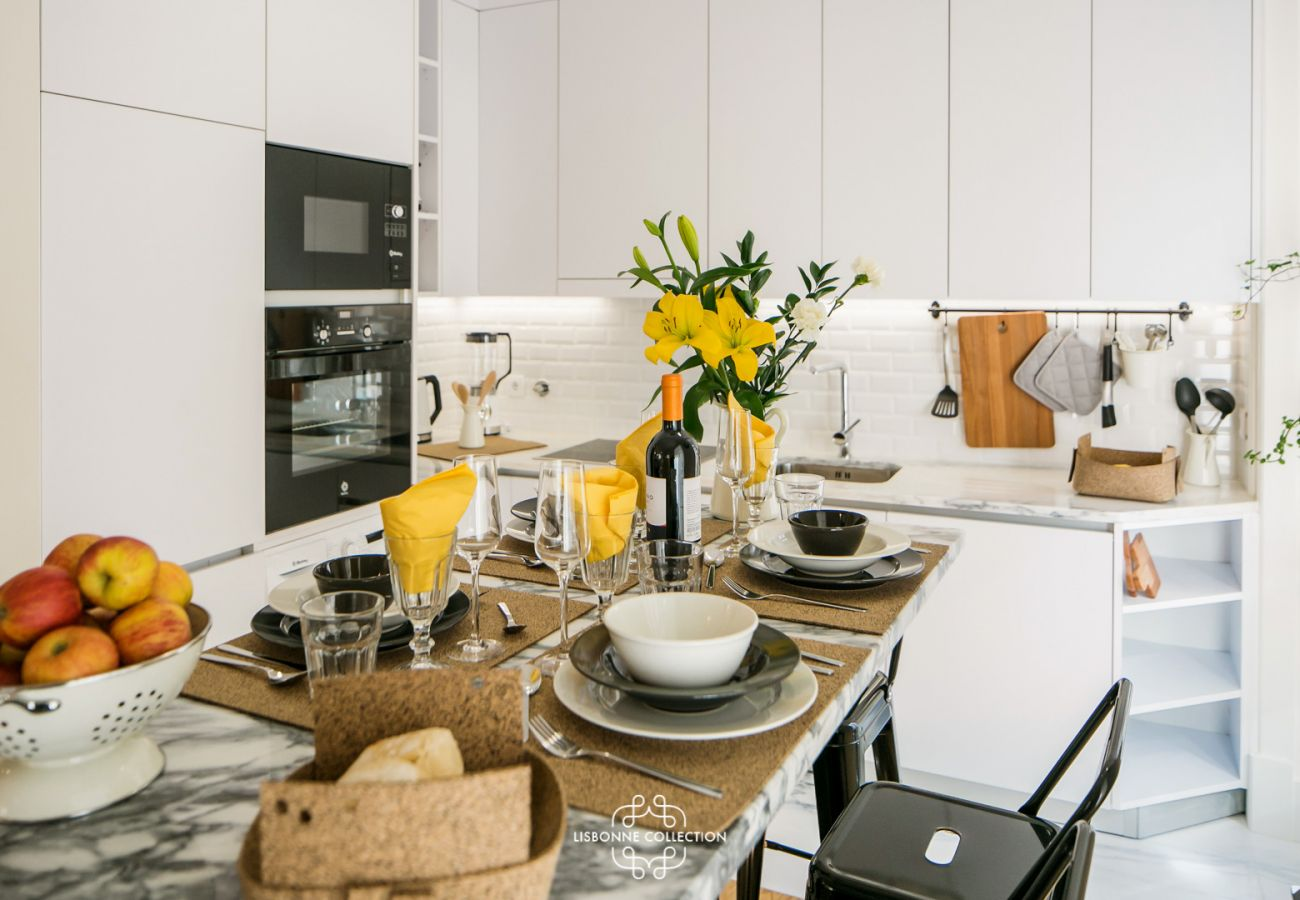 table set overlooking the fully equipped kitchen