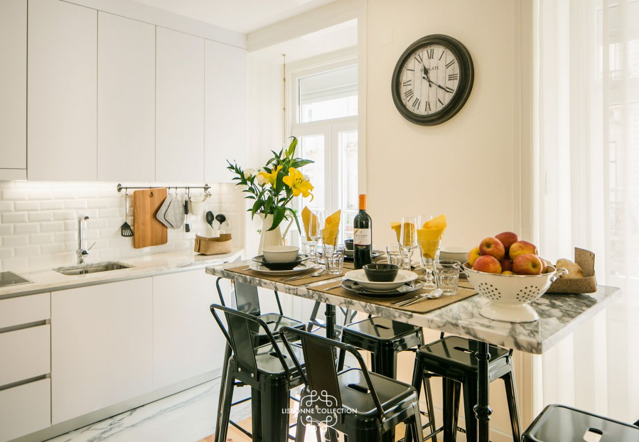 kitchen dining room with marble table and vintage clock