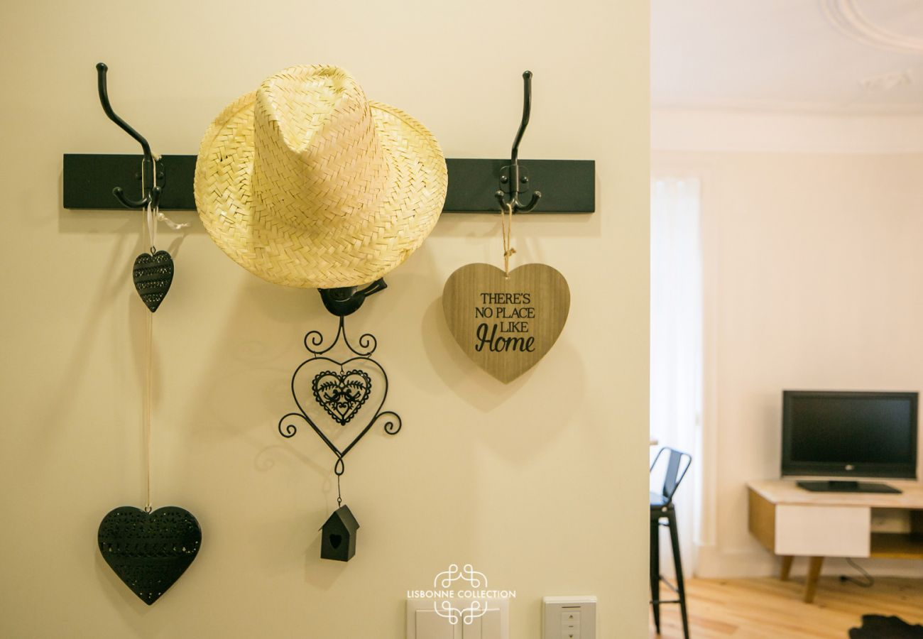 coat rack with yellow straw hat hanging
