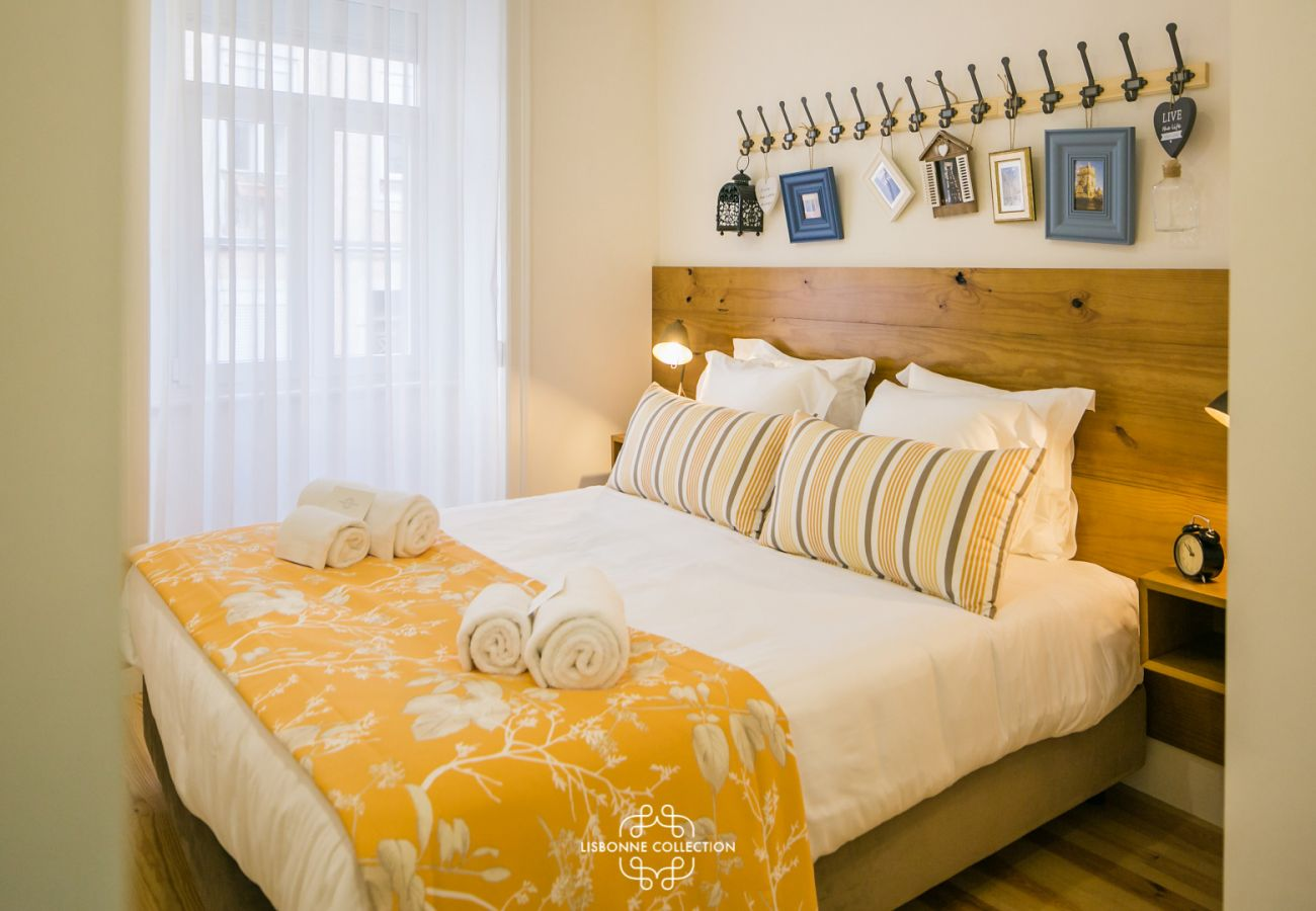 double bed with decoration and a coat rack frieze