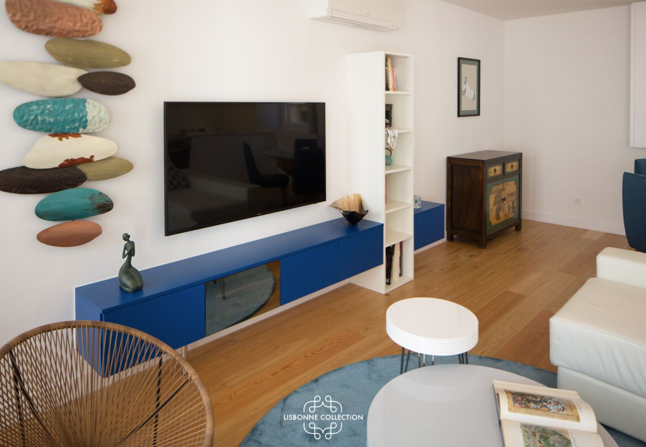 Blue TV stand with big flat screen in downtown Lisbon