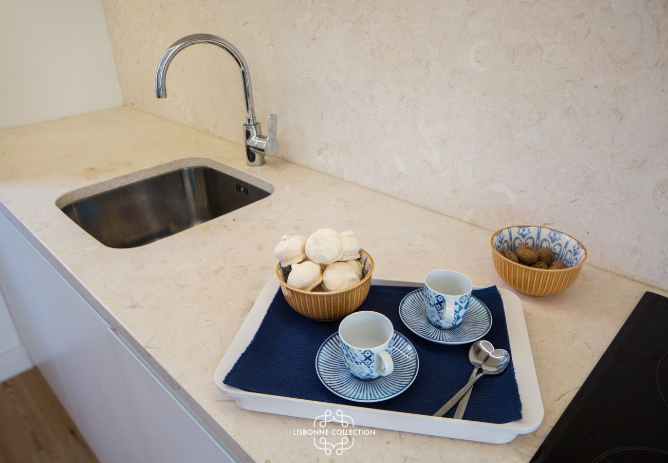 Kitchen with a beige marble worktop