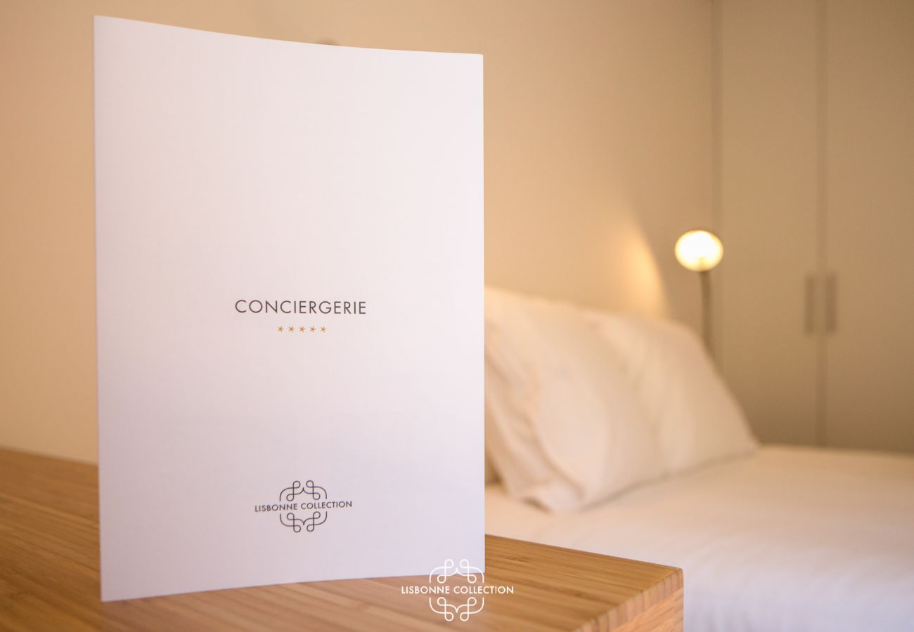 Concierge service plate on bedside table near double bed