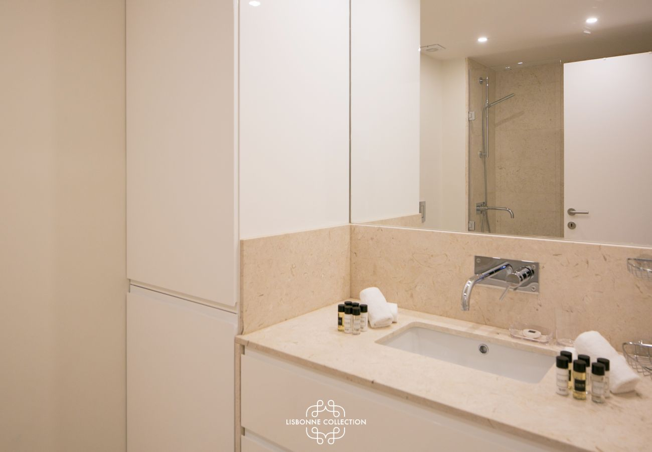 fully equipped bathroom with marble vanity