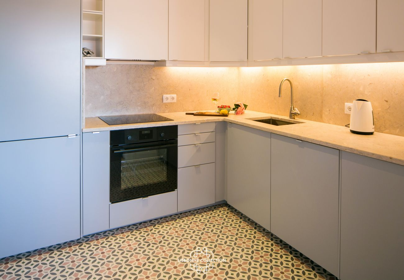 tiled kitchen with oven and hob